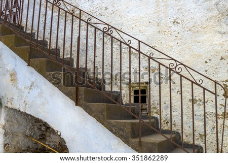 Solid staircase with metal railing in a house in Mykonos, Greece. - stock photo