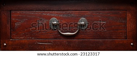 Solid wood end table dresser drawer with silver pewter pull handle. - stock photo