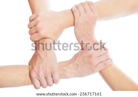 Solidarity concept using joined hands isolated on white background - stock photo