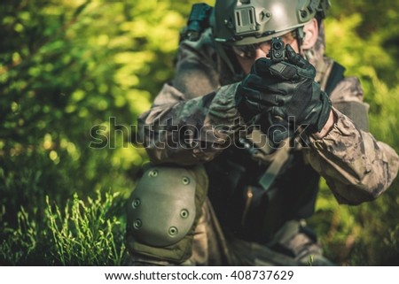 Solider with Handgun. Special Forces Military Mission Concept Photo. - stock photo