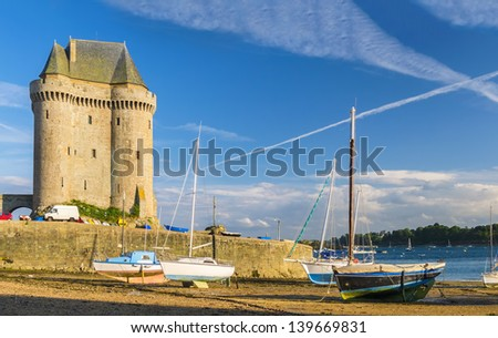 Solidor Tower with boats and yachts laying aground during low tide - stock photo
