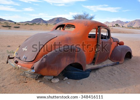 Solitaire, Namibia SEPT, 29: Abandoned car near a service station at Solitaire in the Namib Desert, Namibia. sept, 29, 2014. Solitaire is a small settlemen near the Namib-Naukluft National Park  - stock photo