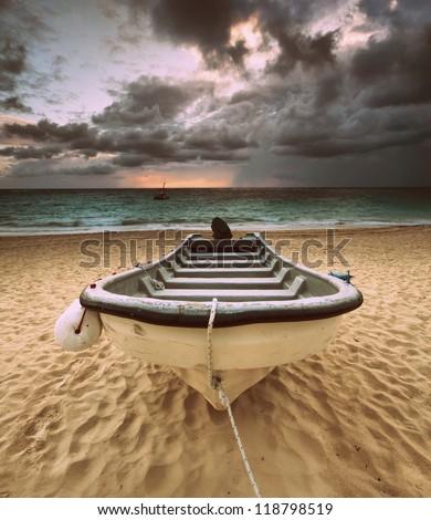 Solitary boat on Bavaro beach in Punta Cana, Dominican Republic - stock photo