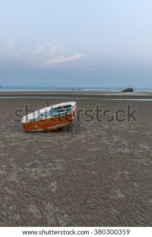 Solitary boat on Palolem beach in south Goa, India - stock photo
