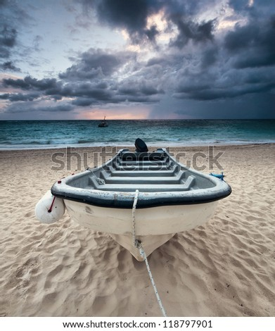 Solitary boat on the beach - stock photo