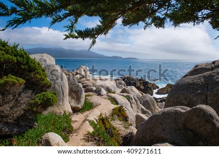 Solitary Coastal Path Along the 17 Mile Drive in Pebble Beach and Pacific Grove California - stock photo