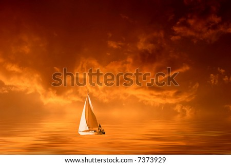 Solitary sailboat on the sea in a cloudy orange sunset.