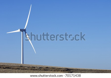 solitary windmill for renewable electric energy production - stock photo