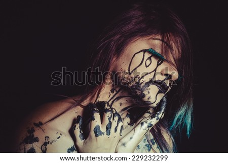 solitude concept, crying woman with tears and makeup dark light - stock photo