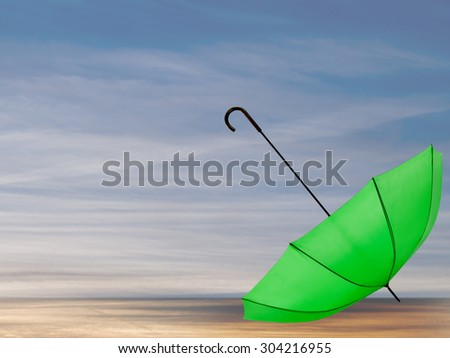 Solitude concept. Green umbrella over deserted beach, background. - stock photo