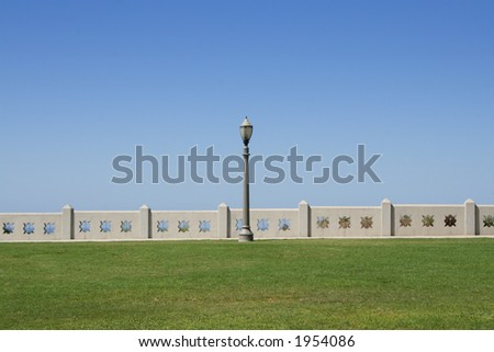 Solitude. lamppost standing alone at a park over the Pacific Ocean. - stock photo