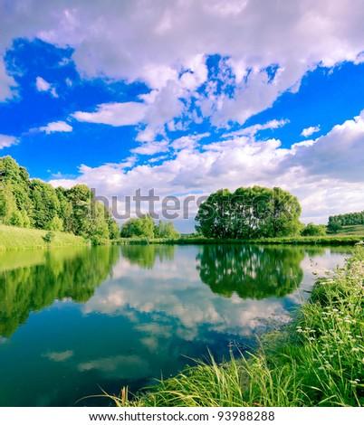 solitude scene of beautiful rural lake - stock photo
