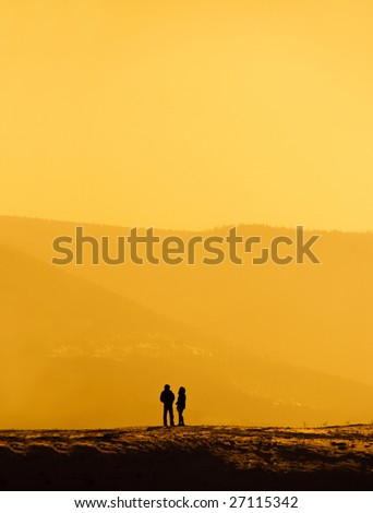 solitude, silhouettes of a man and a woman standing on the hill and talking