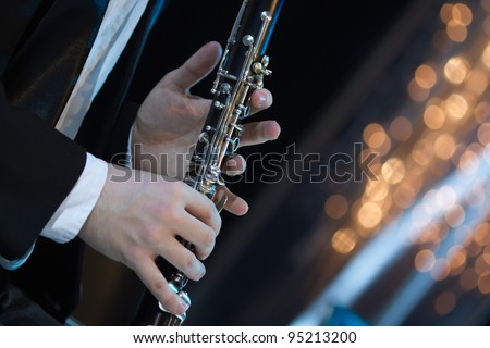 Solo clarinet player performing live on stage - stock photo