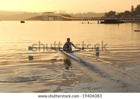 Solo rower at down - stock photo