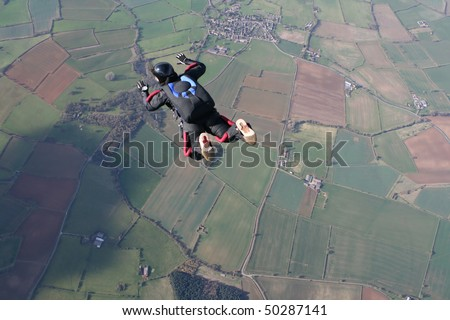 Solo skydiver in freefall - stock photo