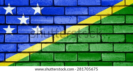 Solomon Islands flag painted on old brick wall texture background - stock photo
