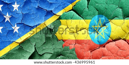 Solomon islands flag with Ethiopia flag on a grunge cracked wall - stock photo