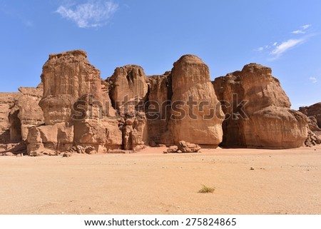 Solomons Pillars, Timna park, Israel. The pillars were formed over 500 million years ago by rain penetrated into fissures in the sandstone - stock photo
