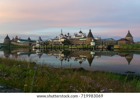 Solovetsky monastery reflecting in the waters of the White sea. Nightfall. North of Russia