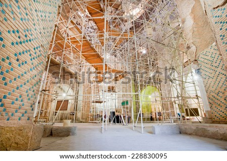 SOLTANIYEH, IRAN - OCT 7: Scaffolding in the ancient buildings for renovation of historical mosque Dome of Soltaniyeh on October 7, 2014. UNESCO World Heritage Site, erected from 1302 to 1312 AD  - stock photo