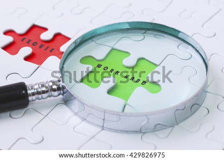 SOLUTION and EXCUSE  puzzle with magnifier glass - stock photo