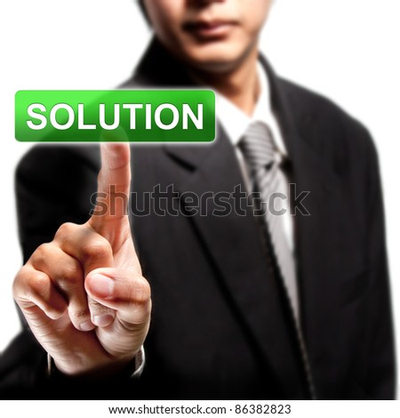 SOLUTION. business man pressing SOLUTION button - stock photo