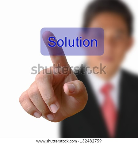 Solution button on keyboard with finger pushing a button