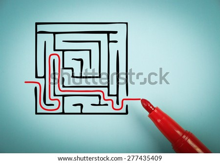 Solution concept is on blue paper with a red marker aside. - stock photo