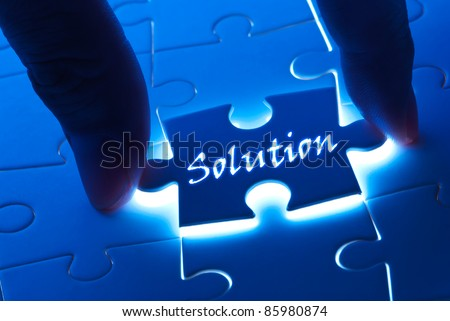 Solution concept, solution word on puzzle piece with back light - stock photo