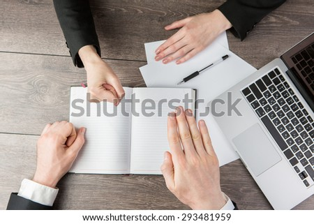 Solution controversial conflicts. Business playing Rock-paper-scissors during the negotiations. Top view. White notes, where you can place your text or information. - stock photo