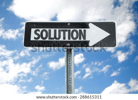 Solution direction sign with sky background - stock photo