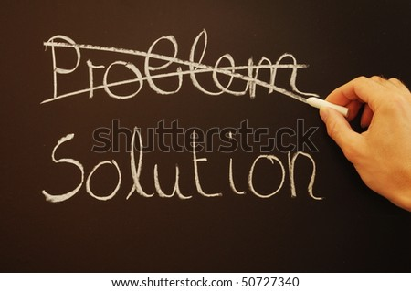 solution for a problem written on a chalk or black board - stock photo