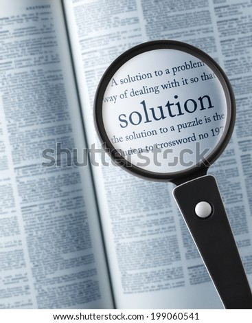 """solution/ Magnifying glass on the""""solution"""" in dictionary - stock photo"""