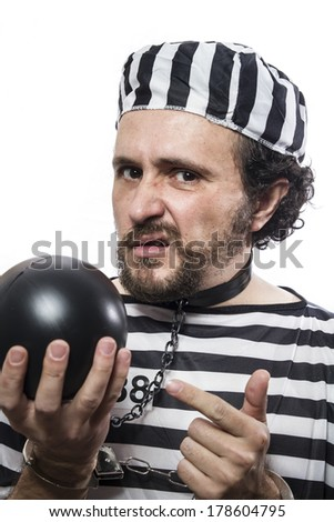 Solution, one caucasian man prisoner criminal with chain ball and handcuffs in studio isolated on white background - stock photo