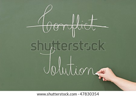 solution rather than conflict,  written in a blackboard - stock photo