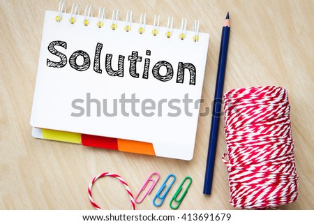solution, text message on white paper and pencil  on wood table / business concept - stock photo