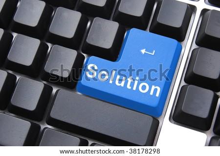solution written on a computer keyboard enter button - stock photo