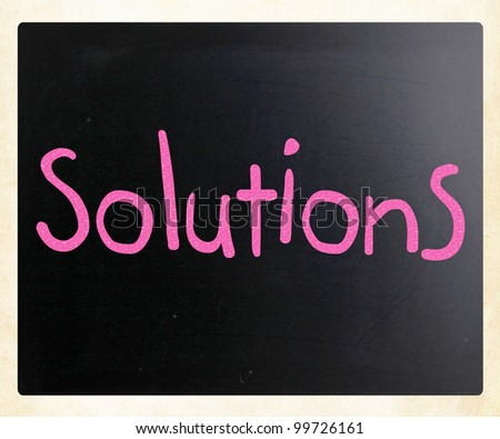 Solutions written with chalk - stock photo