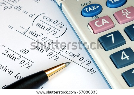 Solve a mathematics question with a calculator - stock photo