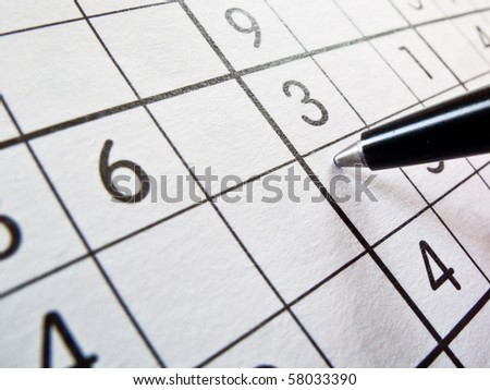 Solving a sudoku puzzle - stock photo