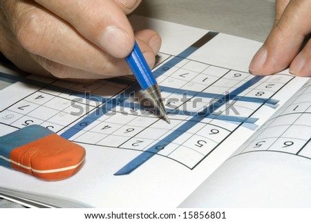 "Solving ""sudoku"" puzzle - stock photo"