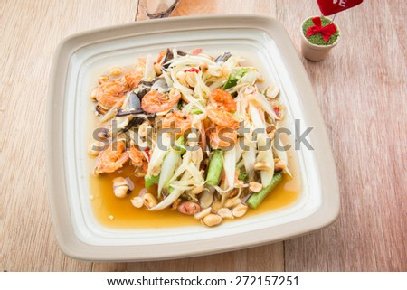 Som-tum, papaya spicy sweet and sour salad with raw crab and dried shrimp,thai food