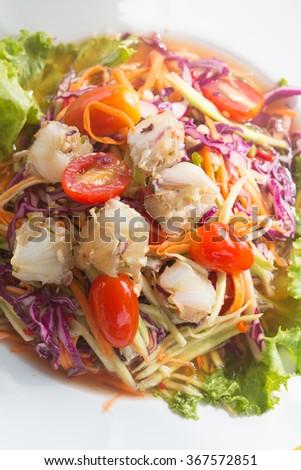 Som Tum Poo, papaya salad with crab. - stock photo