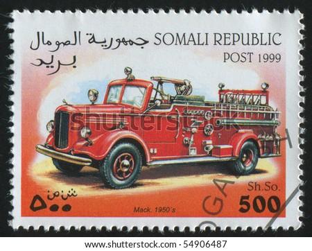 SOMALI - CIRCA 1999: stamp printed by Somali, shows retro car, circa 1999. - stock photo