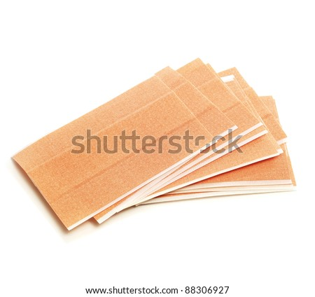 some adhesive bandages on a white background - stock photo