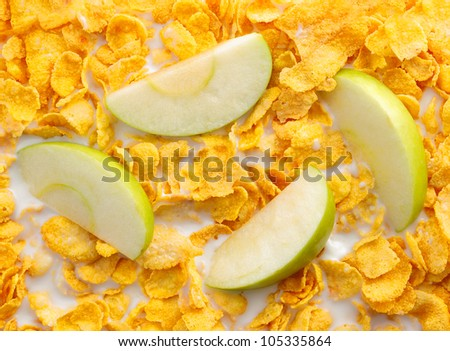 Some apple slices with cereals for breakfast concepts. Cornflakes with milk