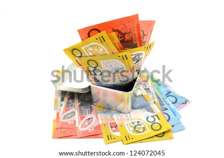 Some Australian banknote in a metal box on white background - stock photo