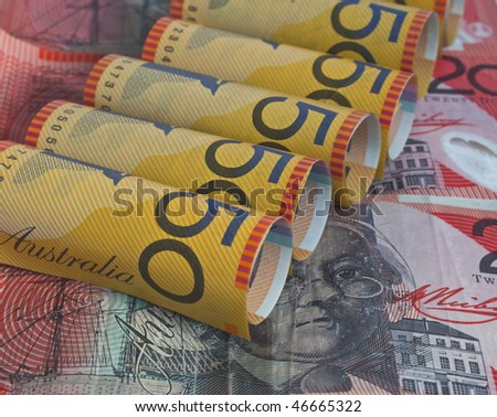 some australian dollars with the fifty dollar bill rolled up - stock photo