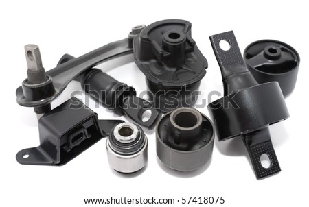 some auto spare parts against white background - stock photo